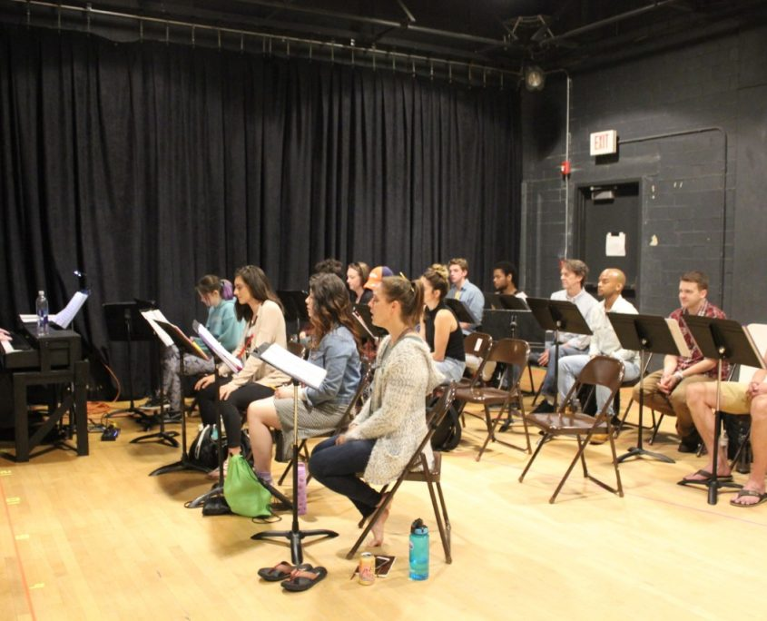 The company attends music rehearsal before their debut of Pippin.
